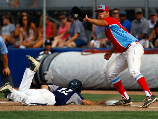 Connecticut Bombers' Zach Ardito dives back to first base to beat the tag from D-BAT Elite 17U first baseman Cole Maxwell on Tuesday in Game 15 of the Connie Mack World Series at Ricketts Park in Farmington.