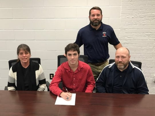 Trevor Mansfield signed to wrestle at Newberry College.