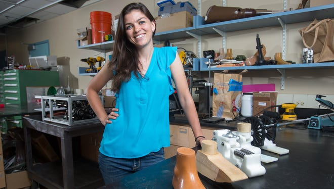 Katy Olesnavage has invented an optimized prosthetic foot and is working with a company in India to produce high performance, mass-producible, low-cost feet to help the 5 million people in India living with lower limb amputations. She is photographed at MIT in Cambridge, MA in June 2016.