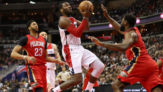 Washington Wizards guard John Wall (2) drives to the basket as New Orleans Pelicans guard Tyreke Evans (1) defends in the fourth quarter at Verizon Center.