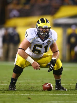 Michigan center Graham Glasgow plays against the Kansas State Wildcats in 2013.