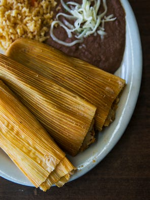 October 18, 2016 - A plate of chicken tamales, wrapped
