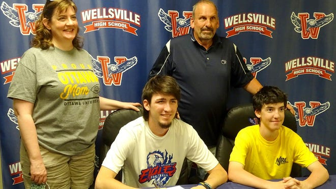 Wellsville High School senior Luke Richards, front left, signed to play football and baseball for Ottawa University. Witnessing the celebration were brother Jake Richards and parents Deidre Fitch and Barry Richards.