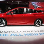 In this Sept. 15 photo, visitors gather around the new Toyota Prius premiered on the first press day of the Frankfurt Auto Show IAA in Frankfurt, Germany.