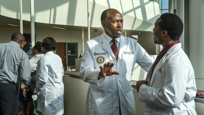 Dr. James Hildreth talks with James Mungrin on Friday, Aug. 14, 2015. A world-renowned AIDS researcher, Hildreth is the new president of Meharry Medical College.