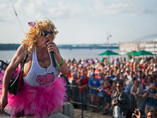 Tim Bethany, 50, singer for the Swine & Dine team, performs during the 2015 Ms. Piggy Idol contest at Tom Lee Park. The event was part of the Memphis in May Barbecue Cooking Contest.