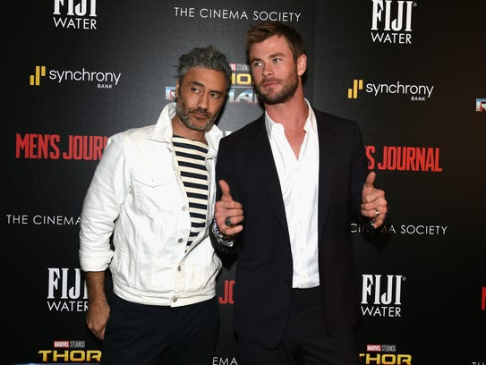 Director Taika Waititi and Chris Hemsworth attend The