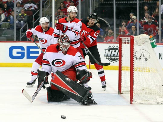 Carolina Hurricanes goaltender Scott Darling (33) makes a save during the second period of their game against the New Jersey Devils at Prudential Center.