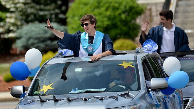 Franklin High School's Tyler Brogan waves from his sunroof during the school's graduation parade on June 5. Brogan was named the Daily News' Boys Cross Country Runner of the Year.