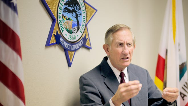 Dean Flippo, Monterey County district attorney, speaks at a press conference about the arrest of six King City, Calif. police officers.