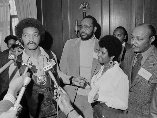 This March 26, 1972 file photo shows the Rev. Jesse Jackson speaking to reporters at the Operation PUSH Soul Picnic in New York as Tom Todd, vice president of PUSH, from second left, Aretha Franklin and Louis Stokes. Franklin died Thursday, Aug. 16, 2018 at her home in Detroit.  She was 76.