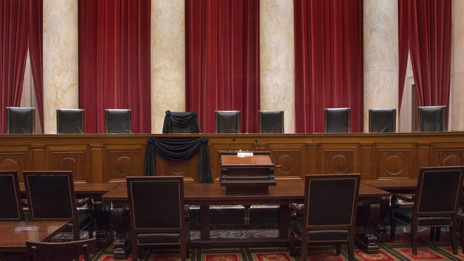 A delay in replacing the late Justice Antonin Scalia would likely mean a number of 4-4 Supreme Court votes. Shown, Scalia's seat is draped in black following his February death.