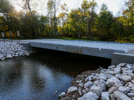 A new bridge built over Crane Creek should help the rainbow trout continue to thrive since they were first put there in 1800s.