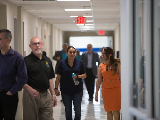 Visitors walk through the halls of  the newly opened