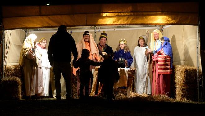 Church members create a live Nativity at First United Methodist Church, 318 National Road W. in Richmond