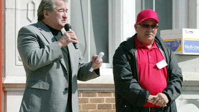Thad Welch, right, is seen with former Superintendent Pat Cooper at a March 2013 ceremony at N.P. Moss Preparatory School. Welch, who was a special assistant to Cooper, has sued for wrongful termination.
