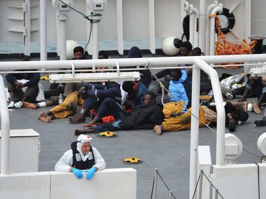 Rescued migrants are aboard an Italian Coast Guard