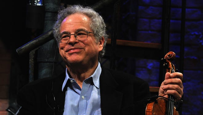 """Violinist Itzhak Perlman appears on """"Late Night with Jimmy Fallon"""" at Rockefeller Center on Feb. 25, 2011 in New York City."""