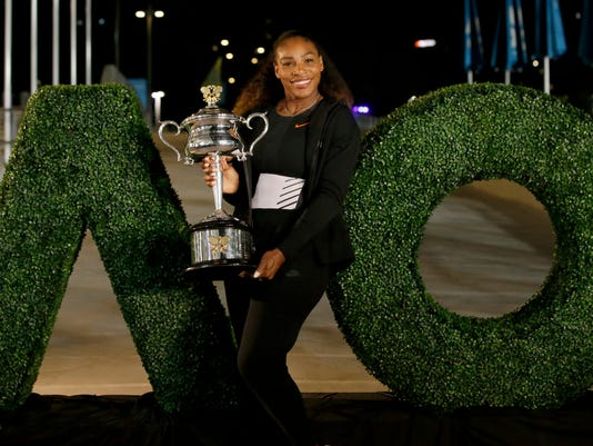 FILE - In this Jan 29, 2017 file photo, United States' Serena Williams poses with her trophy after defeating her sister Venus to win the women's singles final at the Australian Open tennis championships in Melbourne, Australia. Williams, defending champion has withdrawn from the 2018 Australian Open, saying she is not ready to return to tournament tennis. (AP Photo/Aaron Favila, File)