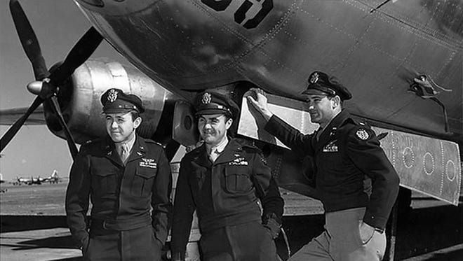 Maj. Thomas Ferebee, right, and the Enola Gay crew in 1945.