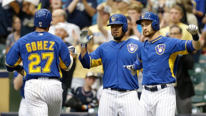 All-Star catcher Jonathan Lucroy (right) and center fielder Carlos Gomez (left) will be key to the Brewers' success down the stretch.