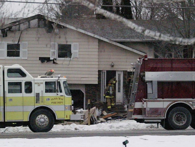 Firefighters battle a house fire on Friday, Dec. 29,