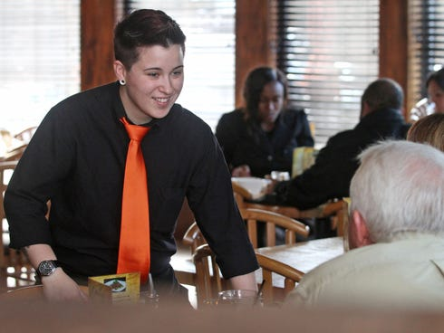 Gallup Asian Bistro waitress Dayna Morales, waits on customers at the Bridgewater restaurant. Morales was recently in the news because a customer left her no tip, writing on the receipt, that they