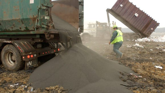 Dumping biosolid pellets at the Waste Management landfill off Outer Loop in 2005.