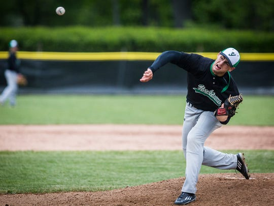 Yorktown's Jake Clawson pitches against Daleville during their county tournament game at Yorktown High School Saturday, May 14, 2016.