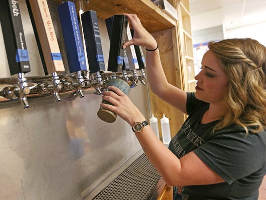 General manager Molly Grooms pours an IPA, Nancy Brew