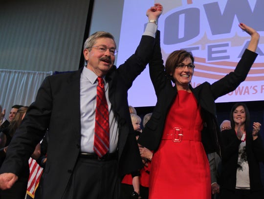 Terry Branstad and Kim Reynolds celebrate victory during
