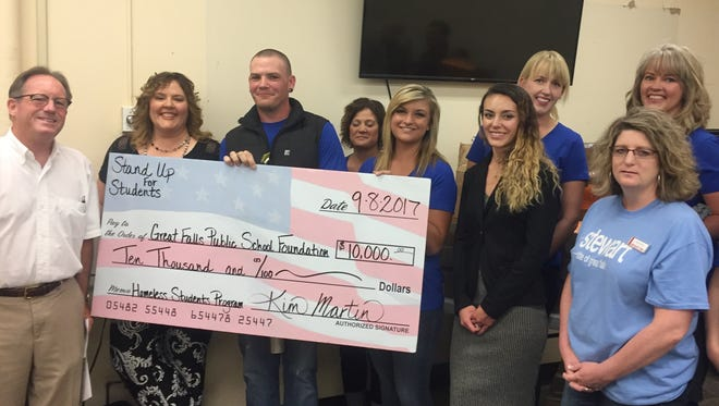 The Great Falls Realtors Association leaders and Young Professional Network presented the Great Falls Public Schools Foundation with a $10,000 check and boxes of toiletries on Sept. 8, 2017.