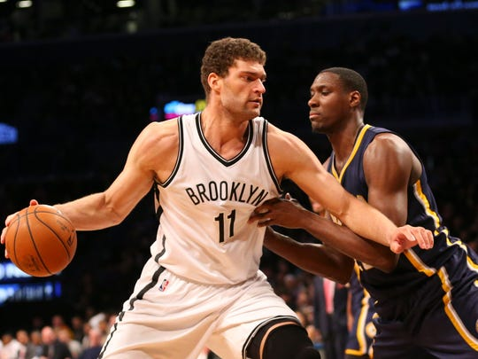 Brooklyn Nets center Brook Lopez (11) drives against Indiana Pacers center Ian Mahinmi (28) during the third quarter at Barclays Center. Brooklyn Nets won 120-110.