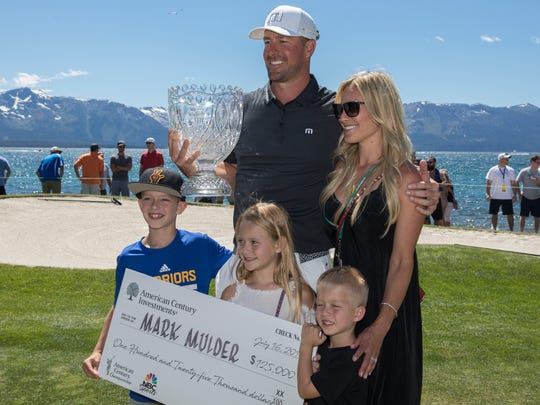 Mark Mulder poses with his family after winning the American Century Championship for the third year in a row at Edgewood Tahoe Golf Course in Stateline, on Sunday.