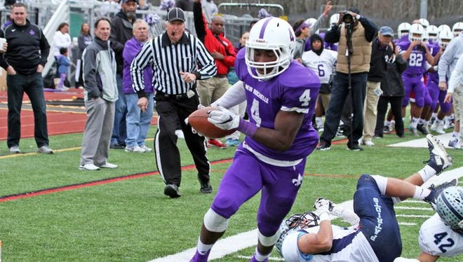 New Rochelle's Keelan Thomas runs for a first quarter touchdown in the Section 1 Class AA championship game at Yorktown High School on Nov. 7, 2015.