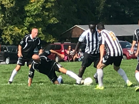 Slide tackles are not allowed in the Irondequoit Fall Soccer League's 40-and-older division, but they do still happen when the competition heats up.