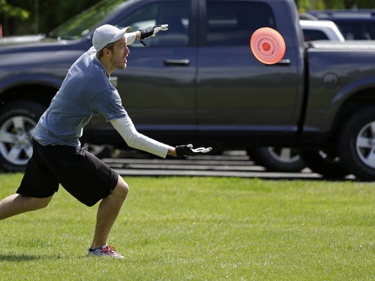 Alex Tews of the Appleton Assassins sprints to make a catch during the Wisconsin Guts Frisbee Championship June 5 at O'Hauser Park in Neenah.