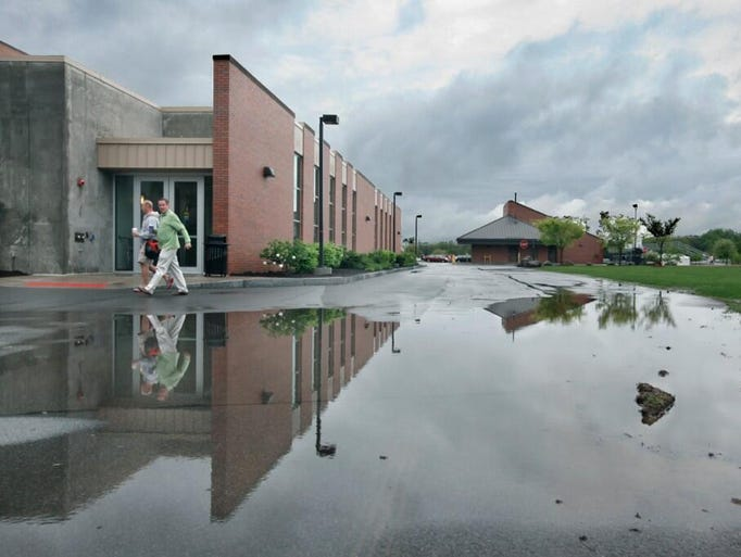 Water accumulates in front of RIT's Ritter Arena Friday.