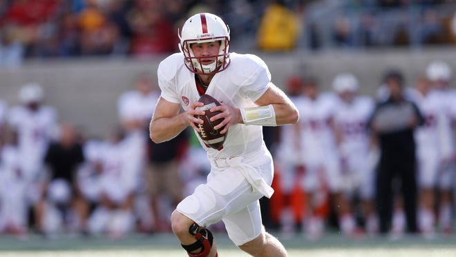 Stanford Cardinal quarterback Kevin Hogan (8) rolls to his left looking for a receiver downfield during the first quarter against the California Golden Bears at Memorial Stadium.