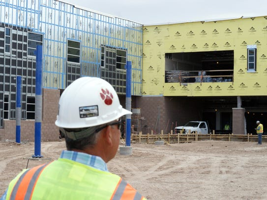"""Herb Borden, construction manager at the Deming Public Schools, displayed a """"Wildcat"""" hardhat issued to construction workers hired locally to work on the new Deming High School construction last May."""