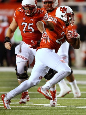 Utah running back Armand Shyne (23) carries against Arizona during the first half of an NCAA college football game, Saturday, Oct. 8, 2016, in Salt Lake City. (