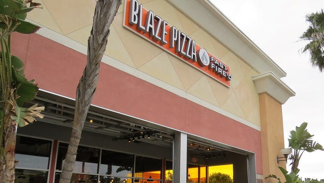 Roll-up, garage-door style windows create a semi-outdoor patio at Blaze Pizza, slated to open March 2 at the Esplanade Shopping Center in Oxnard.