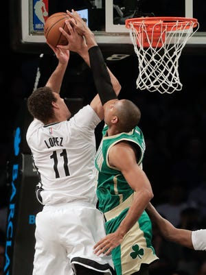Boston Celtics center Al Horford (42) blocks a shot attempt by Brooklyn Nets center Brook Lopez (11) during the fourth quarter of an NBA basketball game, Friday, March 17, 2017, in New York. The Celtics won 98-95.