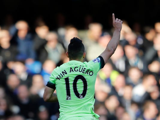 Manchester City's Sergio Aguero celebrates after he scored the opening goal of the game during the English Premier League soccer match between Chelsea and Manchester City at Stamford Bridge stadium in London, Saturday, April 16,  2016. City went on to win the match 3-0, with Aguero scoring all three goals. (AP Photo/Frank Augstein)