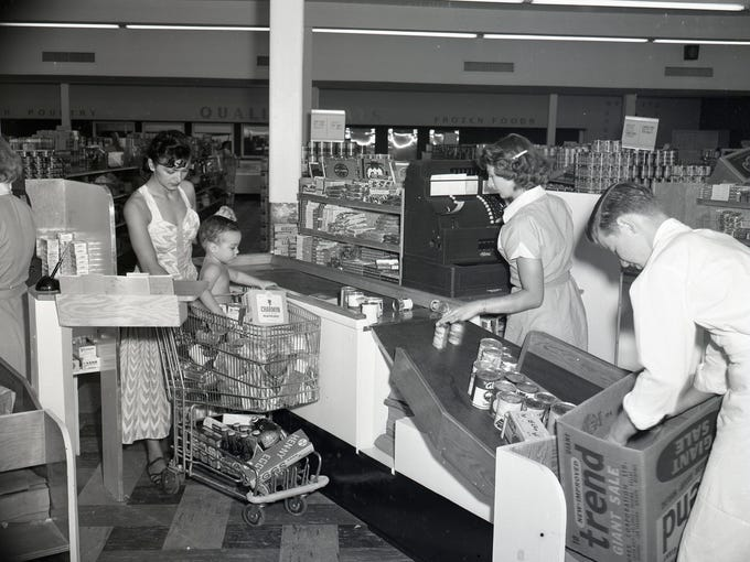 Customers check out at the Suburban MiniMax grocery