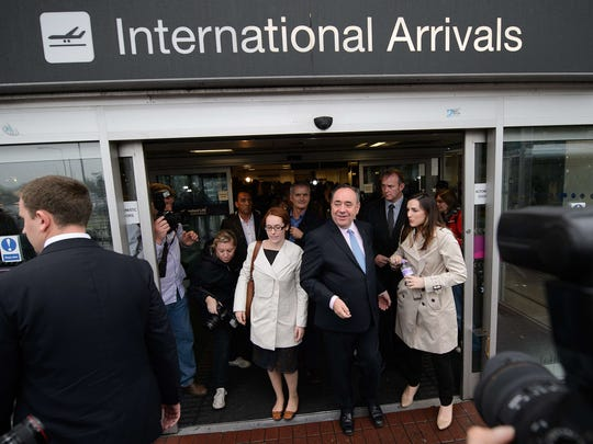 Scotland's First Minister Alex Salmond leaves Edinburgh Airport in Scotland on Sept. 15.