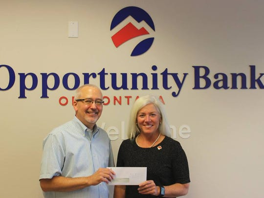 Pictured are Pete Johnson, Opportunity Bank of Montana president and CEO, and Diane Wright, executive director of Red Cross of Montana.