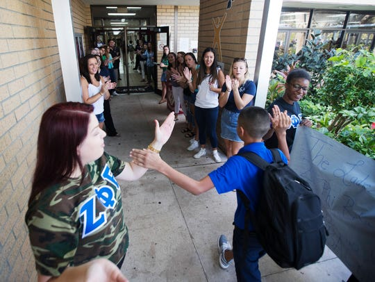 Lehigh Acres Middle School students are greeted by
