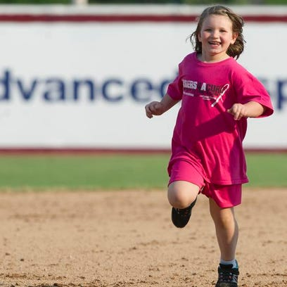 Jenna Mitchell, 6, of Vesper rounds the bases in between