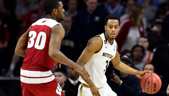 Mar 25, 2016; Philadelphia, PA, USA; Notre Dame Fighting Irish forward V.J. Beachem (3) dribbles against Wisconsin Badgers forward Vitto Brown (30) during the second half in a semifinal game in the East regional of the NCAA Tournament at Wells Fargo Center. Mandatory Credit: Bob Donnan-USA TODAY Sports